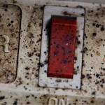 Bed bug fecal spotting on power strip (heavy infestation)